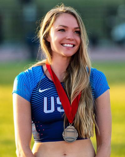 Hawkins poses with her medal