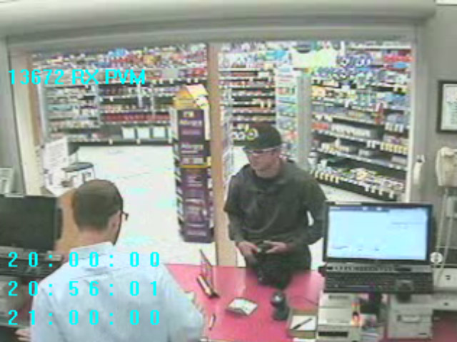 Police Release Photos Of Gunman Who Robbed Walgreens Pharmacy In