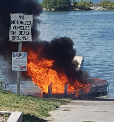 Boat and dock destroyed by fire