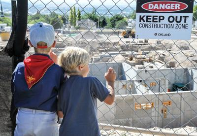 Boys looking at temple construction