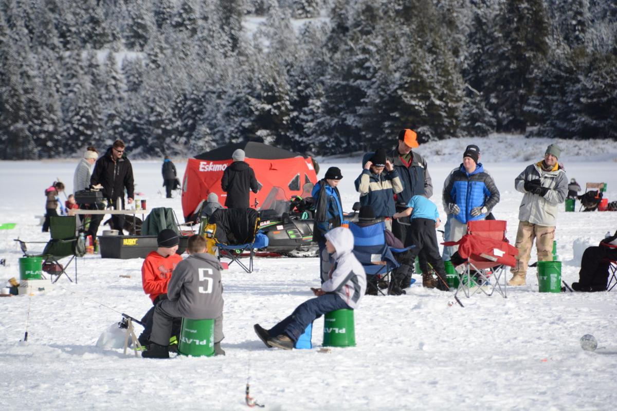 Recreationists ice fishing on Horsethief Reservoir.