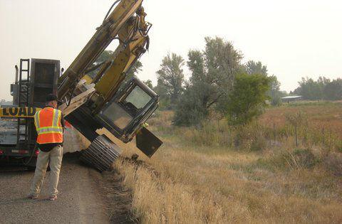 Excavator strikes I-15 overpass