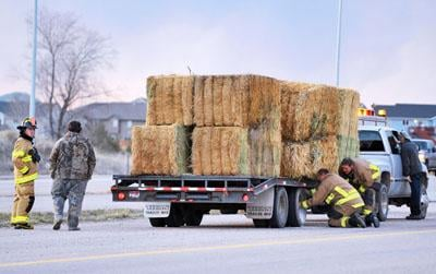 Firefighters respond to truck hauling hay, ISP responds to