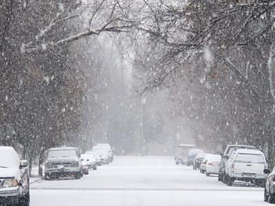 Snow falls on Sixth Avenue
