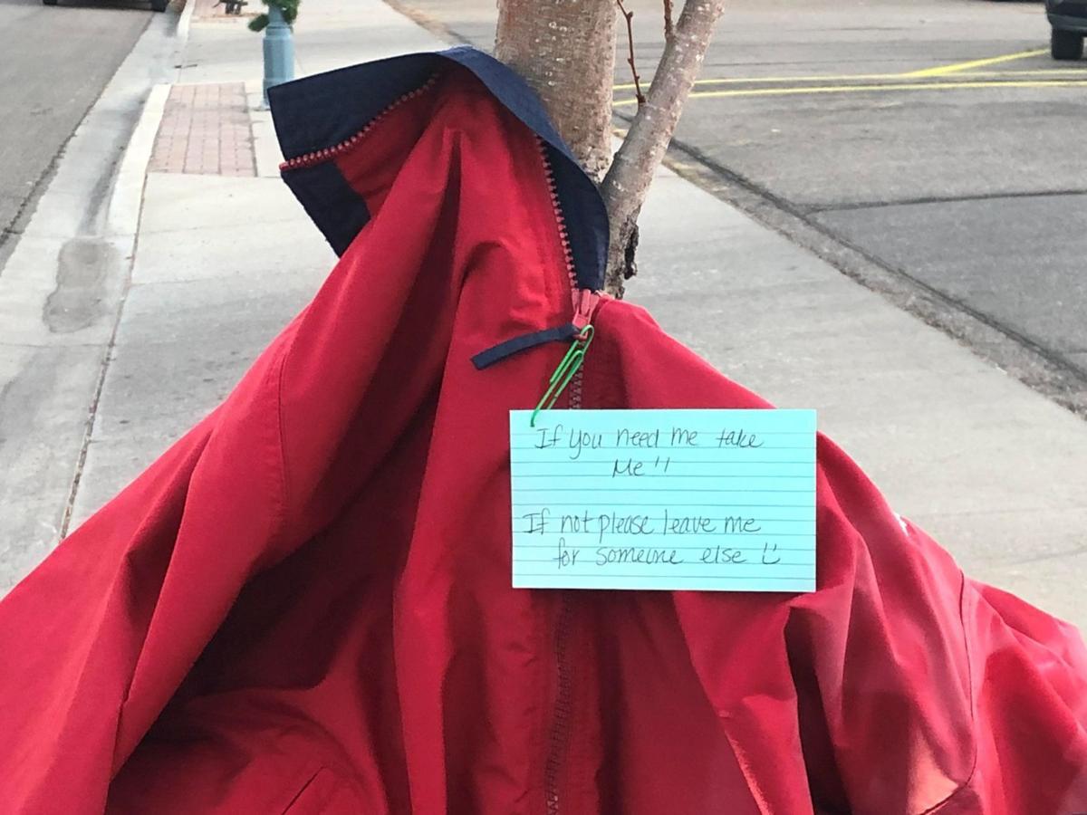 Free coats tied to poles trees