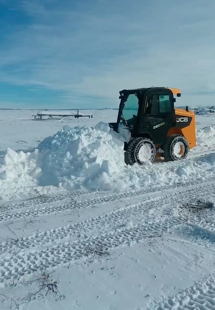 Carson plowing snow