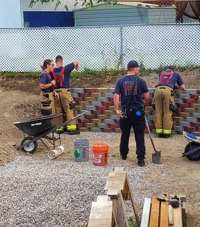 firefighters build wall