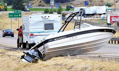 Loose boat lands on I-15: Accident closes one lane of