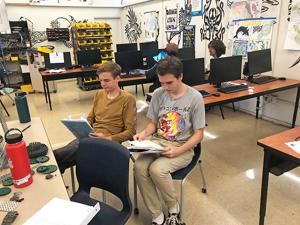 <p>Seniors and members of the Mar Vista Academic Decathlon team Lyle Seymour, left, and Dylan Ralls take time to prepare for one of the many events.</p>