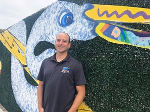 <p>Chris Helmer who has worked for the city fo the past 10 years is the public works &amp; natural resources director. He is pictured behind art work he helped create.</p>