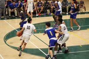 <p>Jeffrey Temcho, a freshman starter on the Mar Vista varsity basketball team, moves towards the basket with sophomore Raul Gonzales ready to help. Temcho scored 8 points, had three assists and seven rebounds in the game against O'Farrell Charter in December.</p>