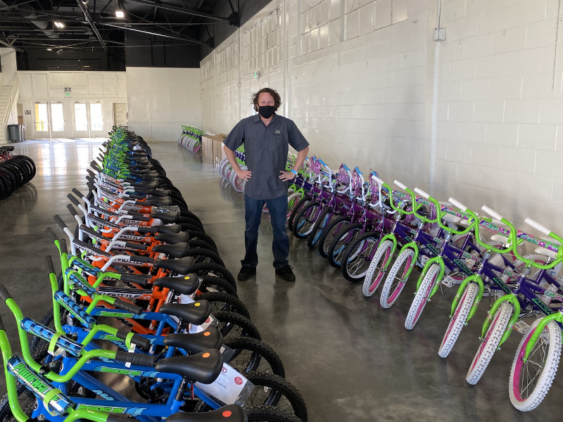 LIV - LVCBrew  Technical Director with finished bikes - Jesse Barto.png