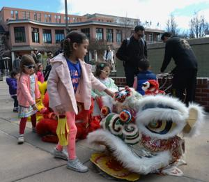 Chinese New Year festivities held on January 18 marked the Year of the Dog. Events in the Bankhead Theater lobby included traditional dancing, demonstrations, food and crafts. A lion dance by KungFu Dragon USA added to the festive occasion. Xiaopei Chinese Dance performed (Photos - Doug Jorgensen).