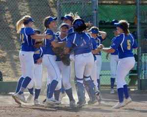 Foothill High School girls varsity softball team defeated Amador Valley 1-0 in EBAL action. The team is shown celebrating the win (Photos - Doug Jorgensen).