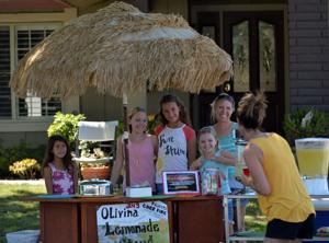Pictured are (from left) Kaitlin Hendricks, Lily Yendrey, Lainey Hendricks, Emma Yendrey, and Sara Yendrey (mom). Ema and Lilys dad, Joseph Yendrey, is a San Jose Fire Battalion Chief at the Carr Fire. He has been there since August 4. The girls opened a lemonade stand to raise money that will be donated to Convoy of Hope to help victims of the fire (Photos - Doug Jorgensen).