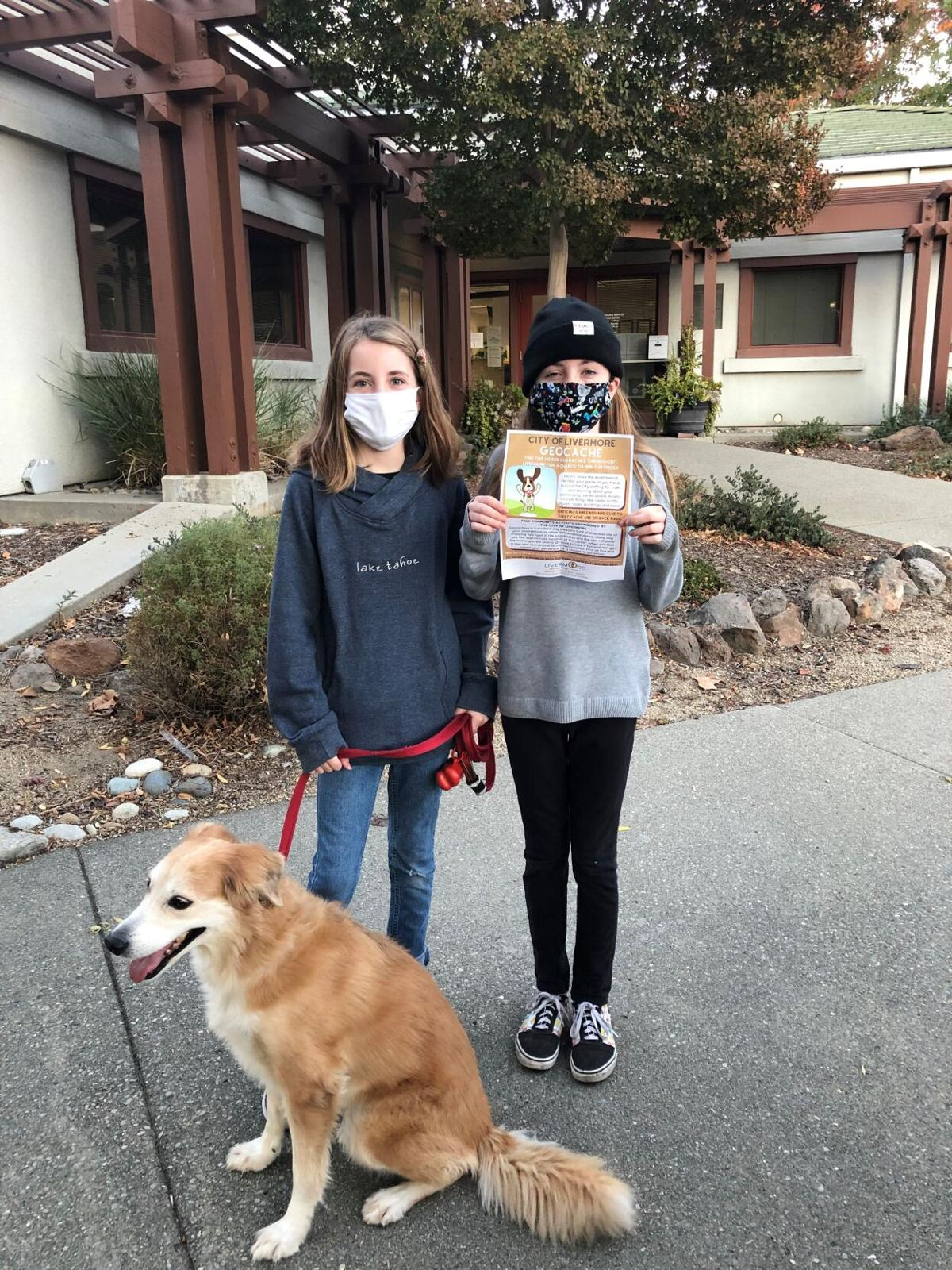 LIV - Geocach - Twins with dog and flier.jpg
