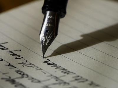 Pen Paper Writing Essay Assignment Aaron Burden Unsplash.jpg