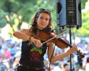 Friday Night Concerts in the Park are a popular way to spend the evening in Pleasanton. Last Friday, July 13, the Gypsy Rebels entertained the audience. The younger set got into the spirit of the music with impromptu dancing. There was an opportunity to raise funds for Animal Assisted Happiness. The organization provides barnyard friends so children and their family members can interact with animals to bring moments of happiness and smiles into their lives (Photos - Doug Jorgensen).