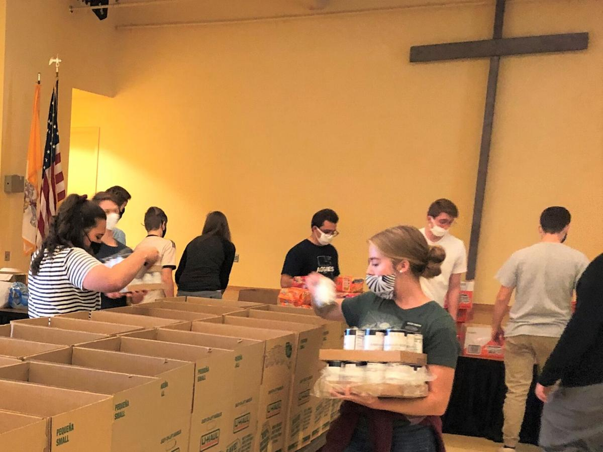 TRI - Missionaries - Filling Boxes at St Raymond.jpg