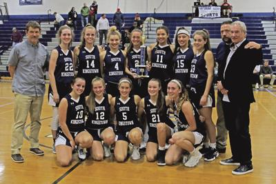 The South Kingstown Rebels girls varsity basketball team and their coaches after defeating the Stonington Bears in the WCCU Holiday Basket Ball Tournament girls championship game played Saturday evening, December 28th, 2019, and Westerly High School. | Karen Stellmaker, Special to The Sun.