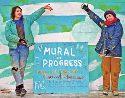 Artists putting finishing touches on scenic mural in Vienna