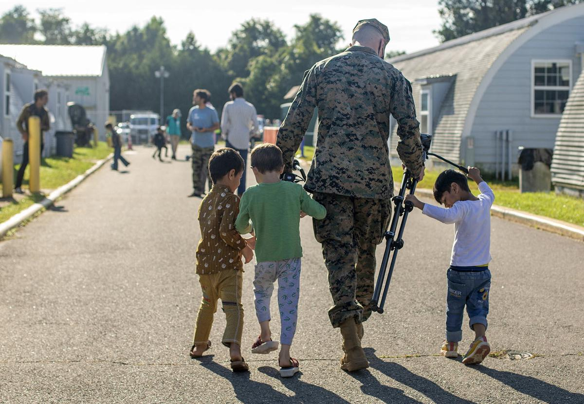 Quantico Afghan refugees children playing with Marine