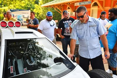 David Ankin, of ToyMakerz, shows off one of his custom rides to Culpeper residents during Culpeper Renaissance Inc.'s annual Car and Motorcycle Show on July ...
