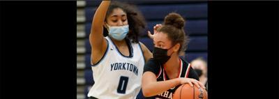Basketball players wearing masks