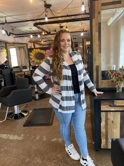 Hair salon owner, mentor starts new chapter at new location