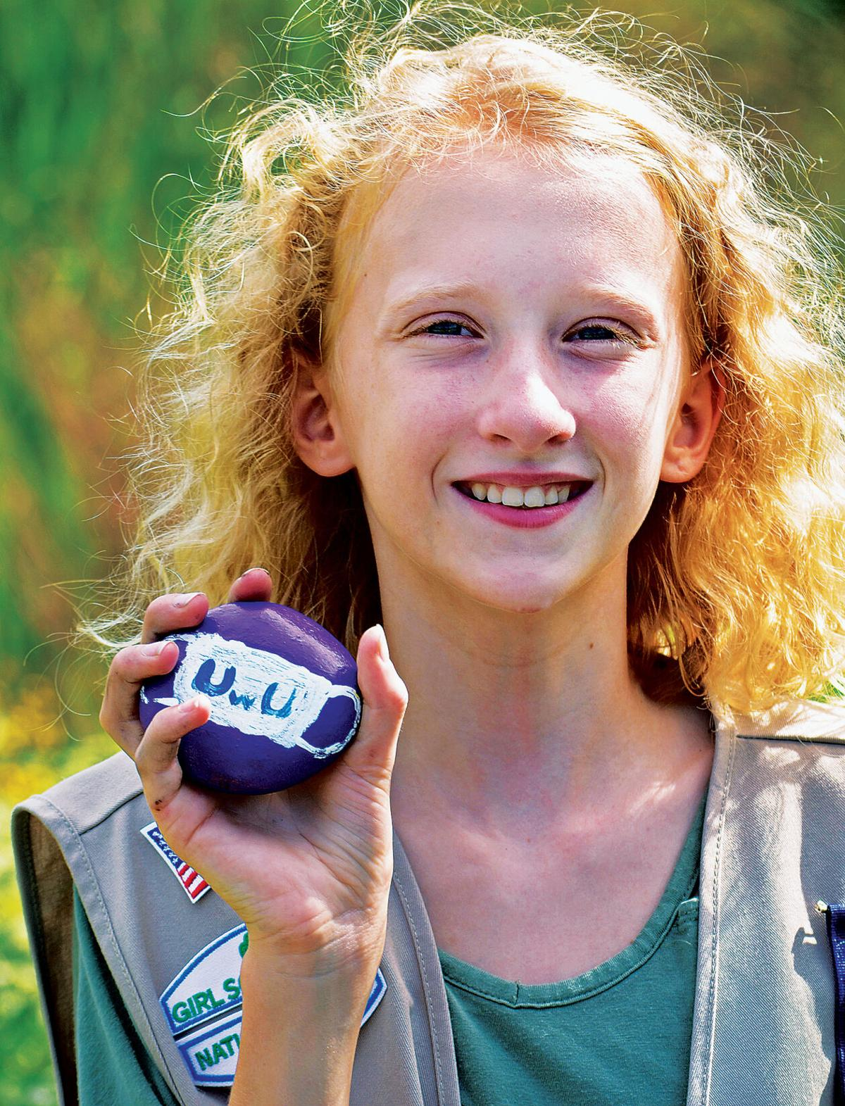 Girl Scouts paint kindness-themed rocks 1