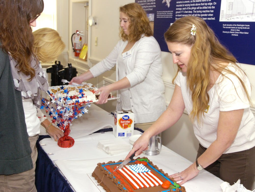 Mara Kaktins Right And Courtney Kuzemchak Serve Birthday Cakes At The 284th Anniversary Of George Washingtons On Saturday