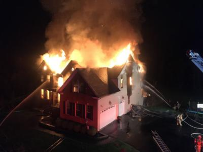 Children jump from window to escape large house fire in