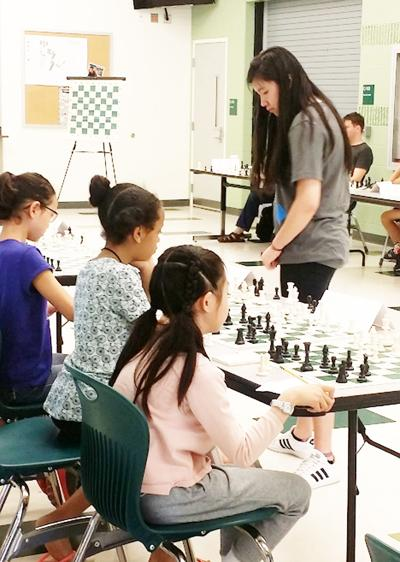 Jennifer Yu takes on competition in chess match