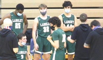 Langley boys basketball huddle
