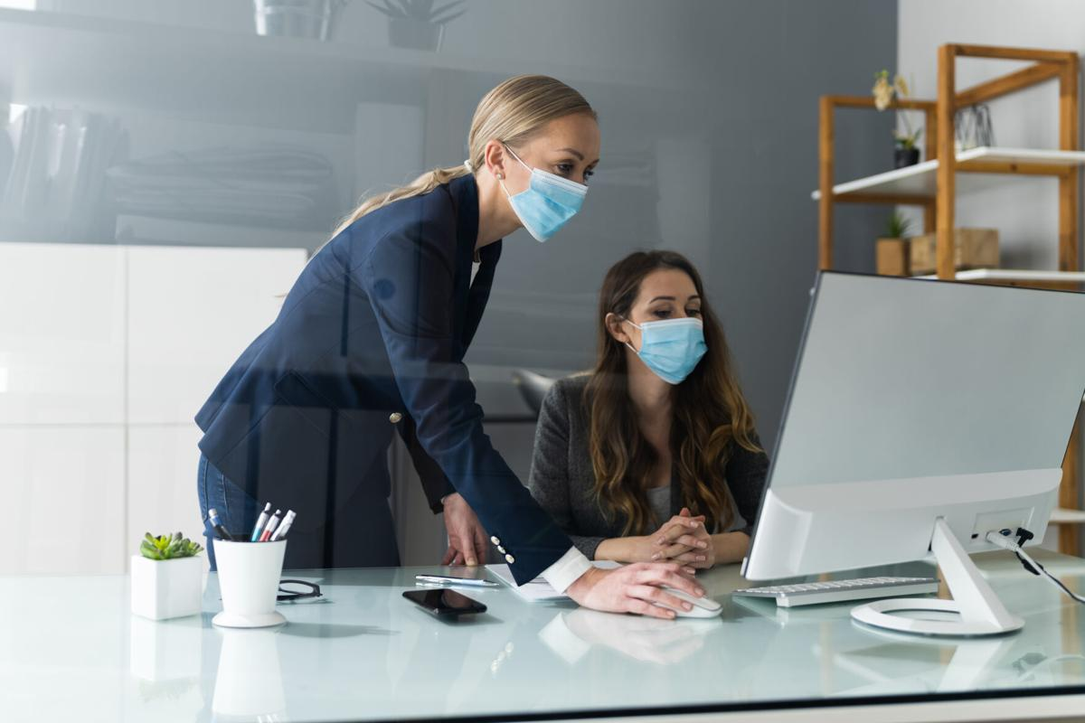 Business Employees Social Distancing With Face Mask In Office