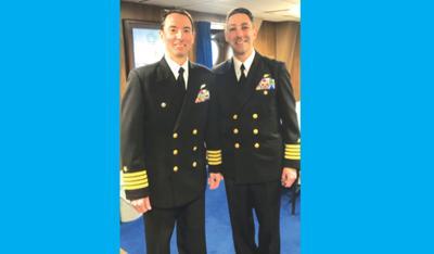 New commander takes helm aboard USS Arlington