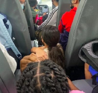 Students sitting on bus floor