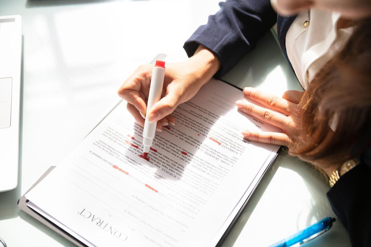 Businesswoman Marking Error In Contract Form