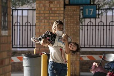 202105-migration-faq-child-upsidedown asylum.jpg