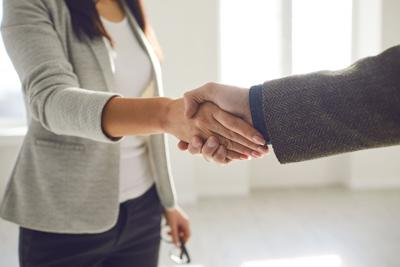 Handshake Of Businesspeople. Female And Male Hand Makes A Handshake In The Office.