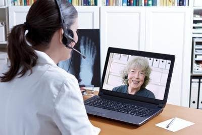 doctor x-ray laptop patient telehealth