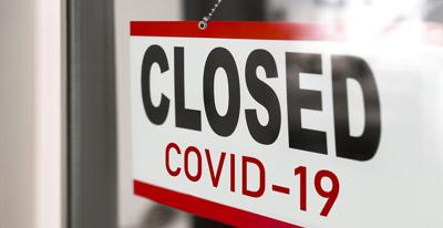 Closed businesses for COVID-19 pandemic outbreak, closure sign on retail store window banner backgro