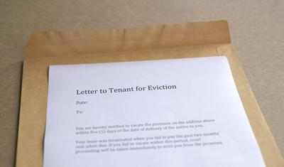 Letter To Tenant For Eviction, On Open Brown Envelope