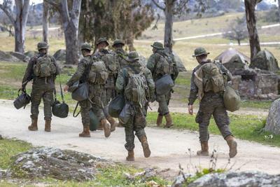 Troop Of Ground Soldiers Walking In The Field