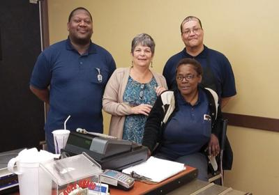 Food service team members (from left) Tony Jones, Sue DiPiazza, Wanda Bradley and Wayne Santiago begin work before dawn to prepare and deliver meals to senior and day care centers across Monroe County.