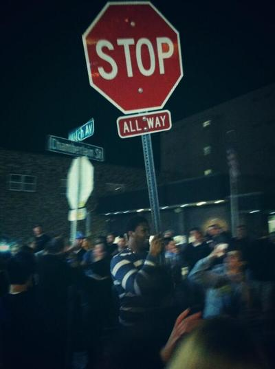 David Irving holding a stop sign