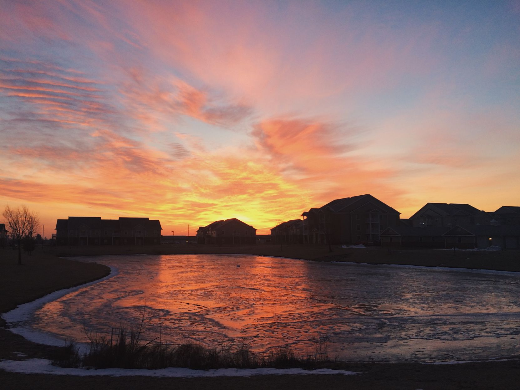 The Sun Rises Over The Pond At The Fountain View Apartment Complex In West  Ames.
