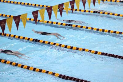 Swimming and diving team head to unique meets respectively