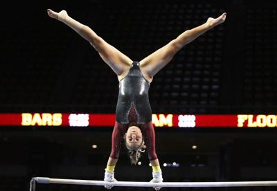 3e2b33bfd3f9 Iowa State gymnast Laura Burns competes during the bars competition at the  gymnastics meet against Southern Utah University at Hilton Coliseum on Feb.  8.