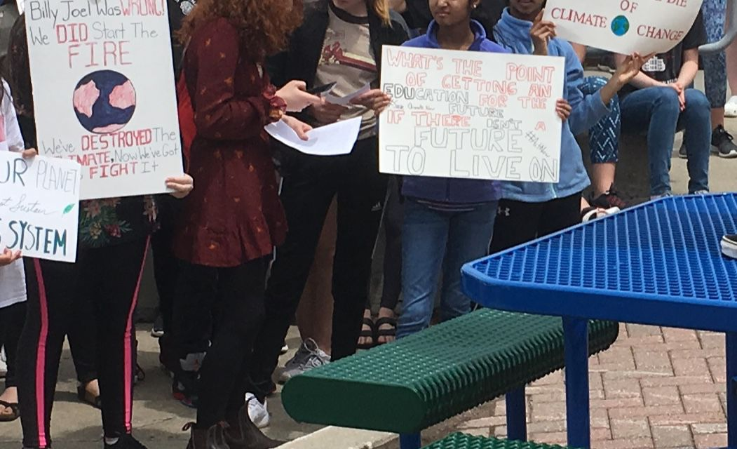 Ames Middle School climate strike signs